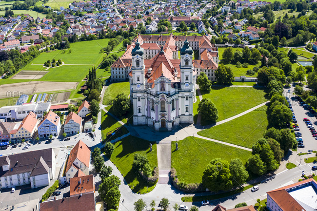 Germany- Bavaria- Ottobeuren- Helicopter view of Ottobeuren Abbey and surrounding town in summer