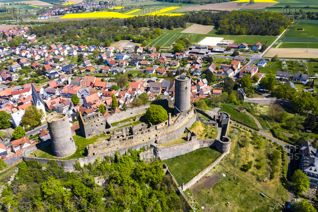 Germany- Hesse- Munzenberg- Helicopter view of Munzenberg Castle and surrounding village in summer