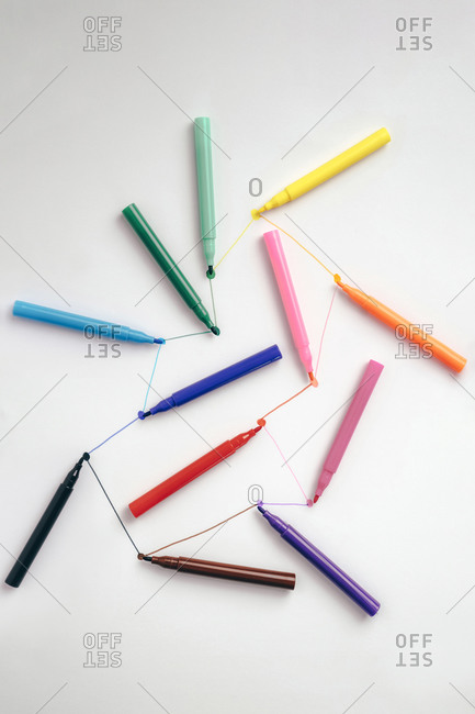Colorful felt tip pens connected with lines