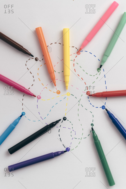 Colorful felt tip pens connected with dotted lines