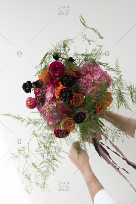 Studio shot of pink- red and purple bouquet of summer flowers
