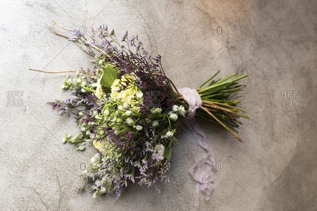 Studio shot of purple bouquet of summer flowers