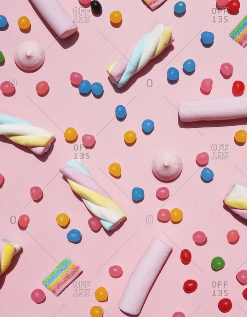Various sweets against pink background