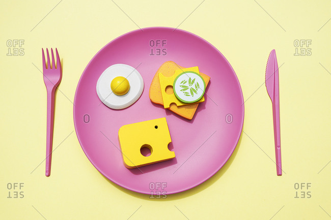 Three dimensional render of plastic plate with bread- cheese and fried egg