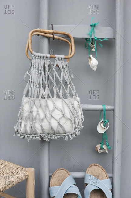 DIY macrame mesh bag- towel- ladder- strings with seashells and pair of sandals
