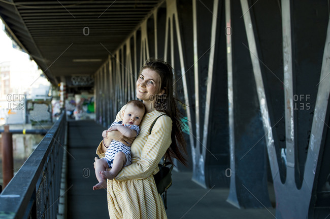 Mother with her baby boy on a bridge