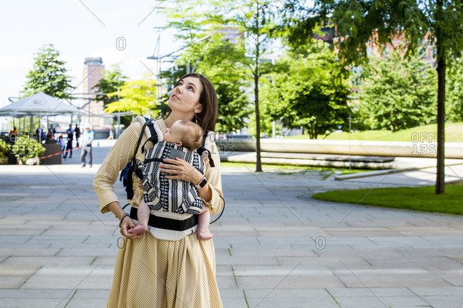 Mother with her baby boy in baby carrier in HafenCity- Hamburg- Germany
