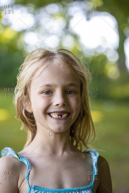 Cute girl with gap toothed standing outdoors