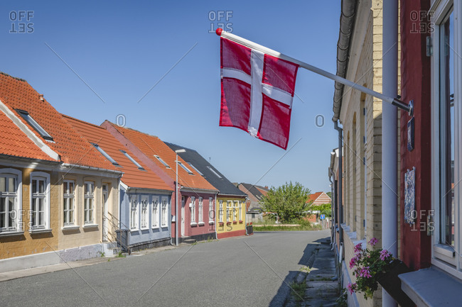 June 15, 2020: Denmark- Region of Southern Denmark- Marstal- Danish flag hanging over empty town street