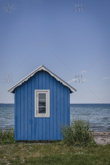 Denmark- Region of Southern Denmark- Aeroskobing- Blue-painted coastal bathhouse