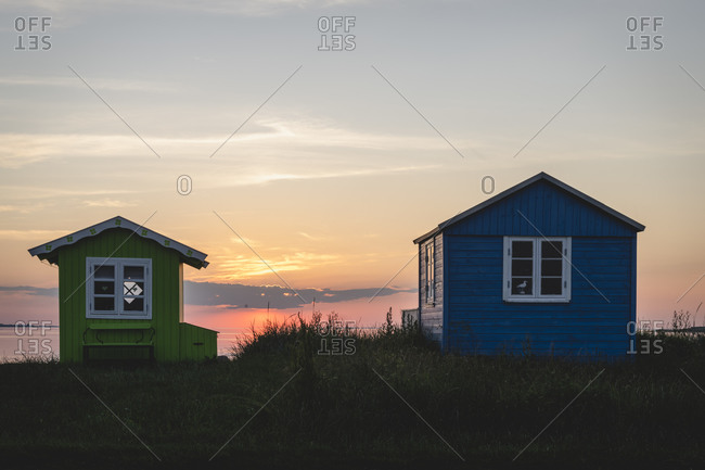 Denmark- Region of Southern Denmark- Aeroskobing- Small coastal bathhouses at sunset