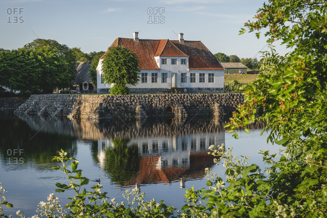June 17, 2020: Denmark- Region of Southern Denmark- Soby- Sobygard museum reflecting in surrounding moat
