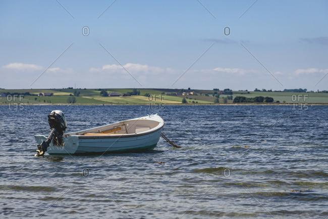 Empty motorboat floating in coastal water