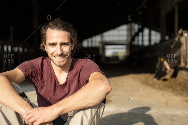 Portrait of a smiling young farmer on a farm