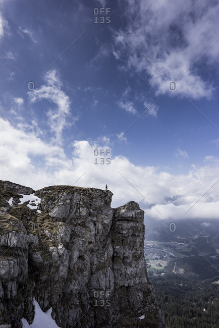 Hiker standing on viewpoint- Saeuling- Bavaria- Germany