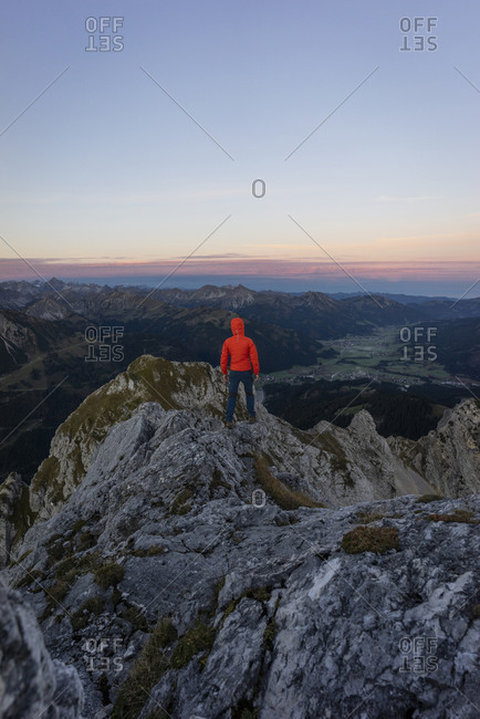 Rear view of hiker on viewpoint during sunrise- Gimpel- Tyrol- Austria