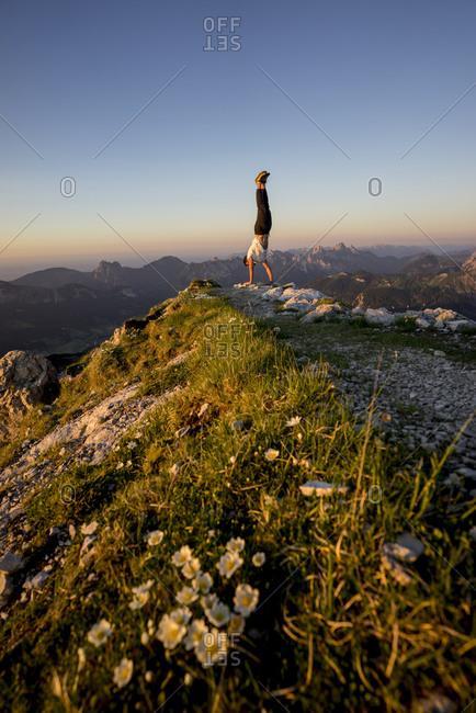 Man doing handstand on viewpoint- Gaishorn- Tyrol- Austria