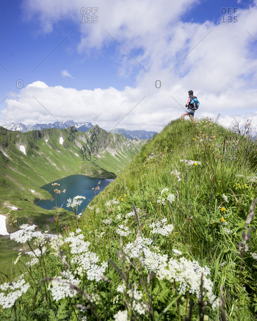 Hiker on viewpoint- Lake Schrecksee- Bavaria- Germany