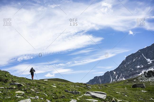 Man hiking on mountain of Western Rhaetian Alps- Sondrio- Italy