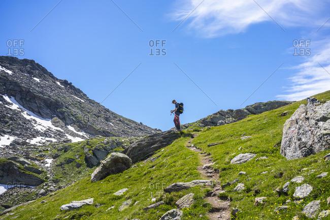 Man on hiking trail of mountain at Western Rhaetian Alps- Sondrio- Italy