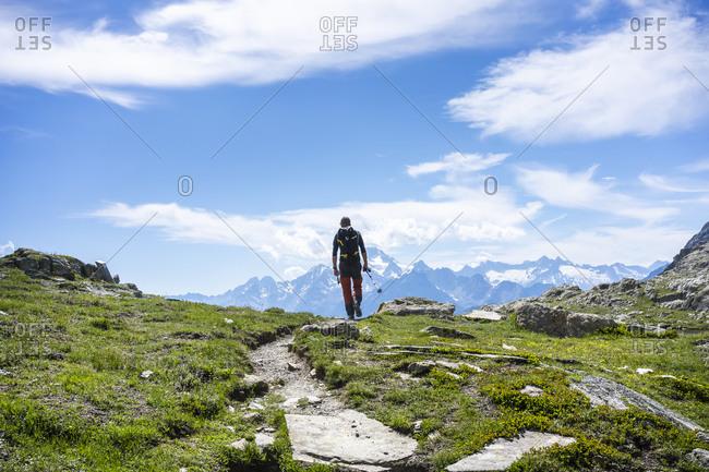 Man hiking on mountain path at Western Rhaetian Alps- Sondrio- Italy