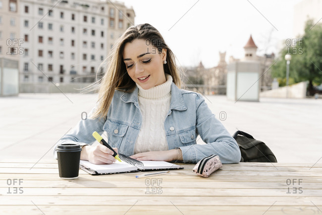 Female student studying at table in university campus
