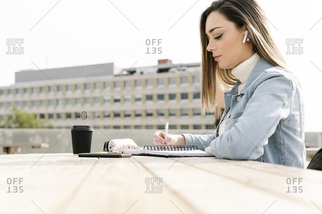 University student studying at table in campus