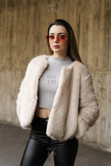 Fashionable woman wearing sunglasses in city