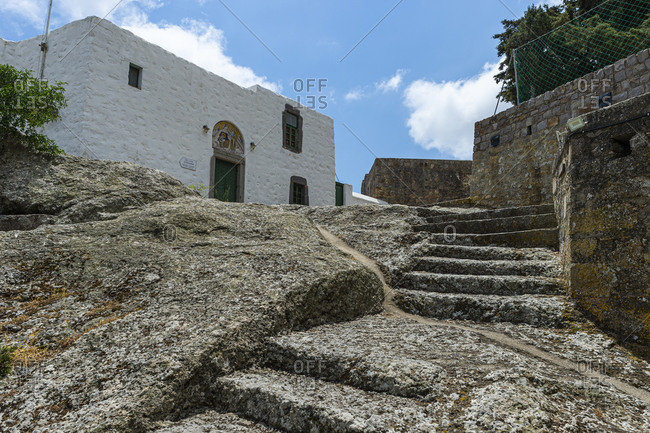 June 22, 2020: Greece- South Aegean- Patmos- Stone steps leading to entrance of Cave of the Apocalypse