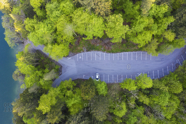 Drone view of empty parking lot on shore of Alatsee lake