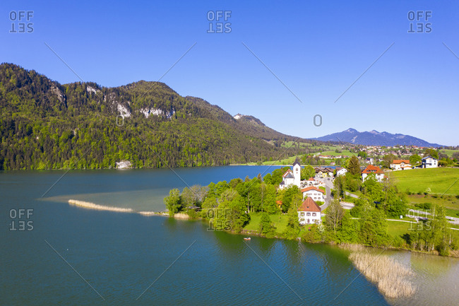Germany- Bavaria- Fussen- Drone view of village on shore of Weissensee lake