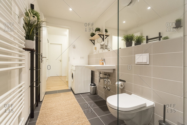 Clean modern bathroom with washer