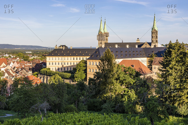 Germany- Bavaria- Bamberg- Bamberg Cathedral and surrounding old town buildings at dusk