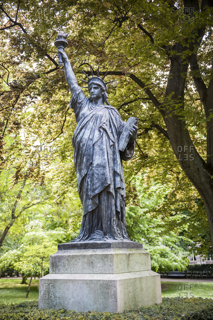 France - April 26,  2019: Statue of Liberty enlightening the world. Replica standing in Luxembourg gardens,  Paris,  France