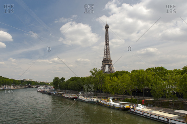 Houseboats on river Seine before Eiffel tower,  Paris,  France