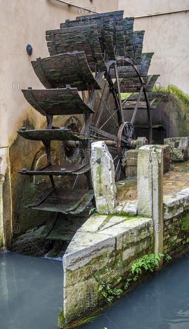 Italy - September 18,  2015: Italy,  Veneto,  Treviso,  paddle-wheel on a canal