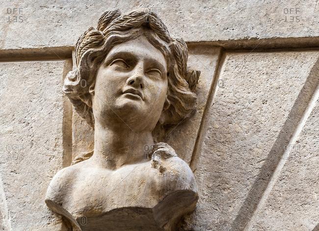Italy - September 19,  2015: Italy,  Veneto,  Verona,  palace on Porta Borsari street,  bust (Ceres,  summer)