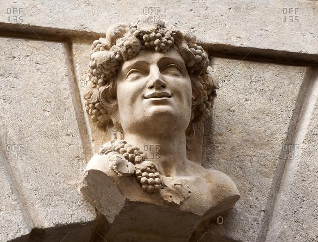 Italy - September 19,  2015: Italy,  Veneto,  Verona,  palace on Porta Borsari street,  bust (Bacchus,  autumn)