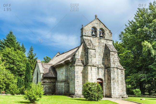 France,  Limousine,  Coreze,  Lestards village,  church Saint Martial (12th-15th century,  Historical Monument) with tatched roof (12th-15th century,  Historical Monument)