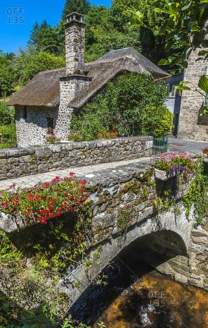 France,  Limousine,  Correze,  Gimel-les-Cascades,  Peage bridge and granite house with tatched roof