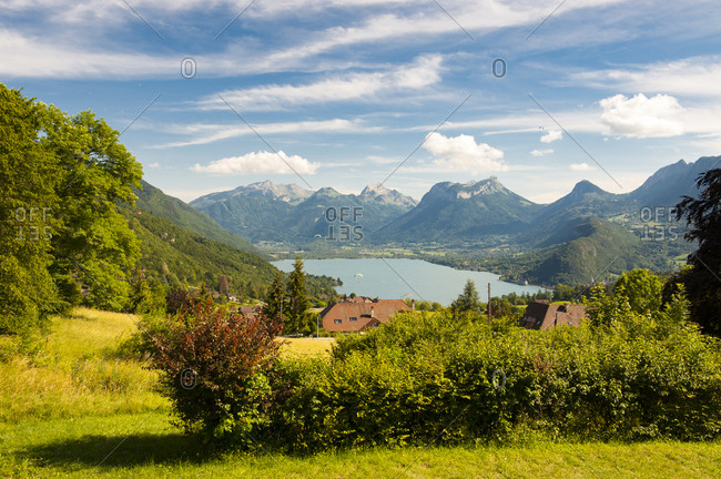 France,  Savoie,  Annecy,  panoramic view of the Lake flown over by paragliders