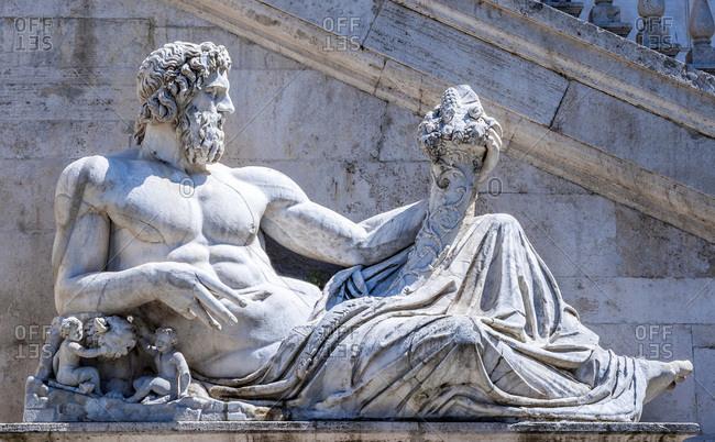 Italy - May 8,  2015: Italy,  Rome,  Capitoline district,  Piazza del Campidoglio,  statue at the foot of Palazzo Senatorio