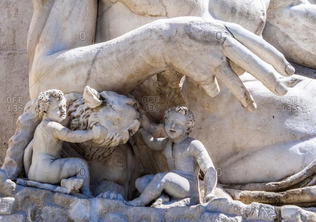 Italy - May 8,  2015: Italy,  Rome,  Capitoline district,  piazza del Campidoglio,  statue detail at the foot of the Senatorio palazzo
