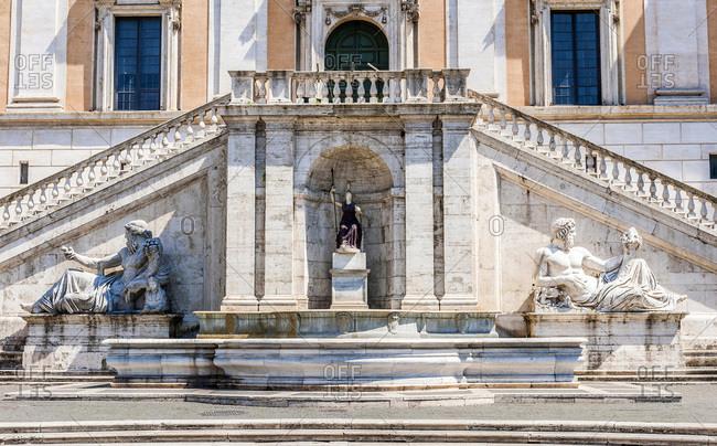 Italy - May 12,  2015: Italy,  Rome,  Capitoline district,  fountain and staircase of the palazzo dei Senatori (12th-17th centuries,  nowadays city hall) in Piazza del Campidoglio