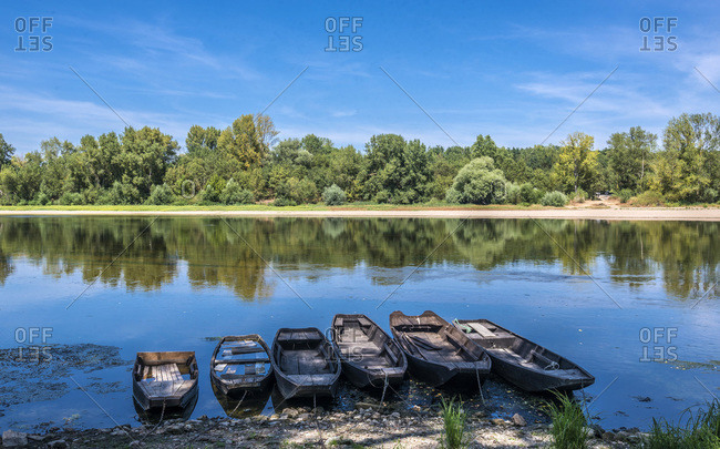 France,  Loire Valley,  Pays de la Loire,  Maine-et-Loire,  boats on the Loire at Candes-st-Martin (UNESCO World Heritage) (Most beautiful village in France)
