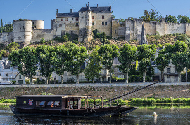 France - July 23,  2019: France,  Center-Val de Loire,  Indre-et-Loire,  Royal Fortress of Chinon,  Vienne and boat.
