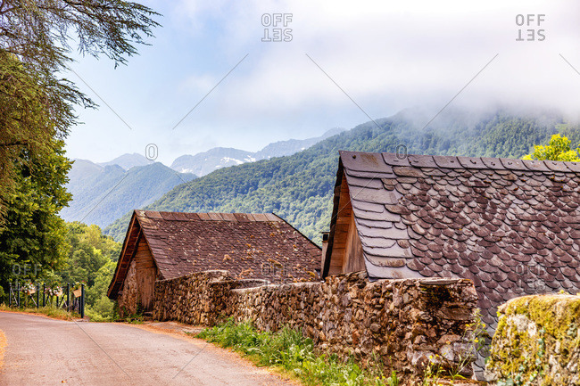 stone house in the village of Audressein in Ariege department,  in Pyrenees mountains,  Occitanie region,  France