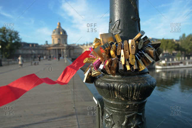 France,  Paris,  75,  1st arrondissement,  pont des Arts,  close-up of love padlocks attached to the foot of a lamppost.