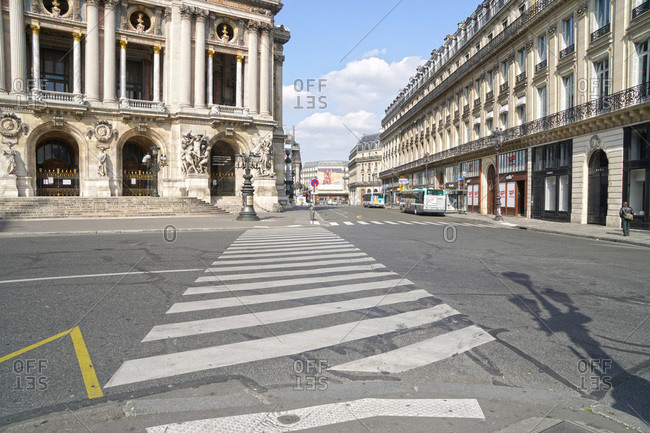 France - March 19,  2020: France Paris,  9th arrondissement 20/03/20. No traffic on empty place de l�Opera,  due to the containment obligation decided by the French Government to fight the coronavirus epidemic.