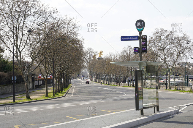 France - March 19,  2020: France Paris,  7th arrondissement 20/03/20. Empty street in front of the National Assembly,  due to the containment obligation decided by the French Government to fight the epidemic.